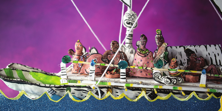 Several model figures in a model canoe at sea, against a purple background.