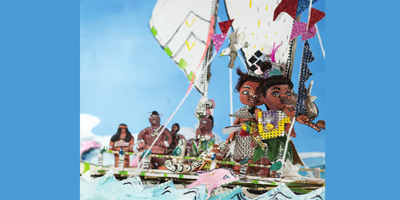 Several handmade model figures in a model canoe in the ocean waves.